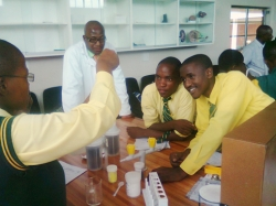 LEARNERS ARE ENJOYING CONDUCTING EXPERIMENTS IN THE PHONGOLA EDUCATION CENTRE SCIENCE LABORATORY
