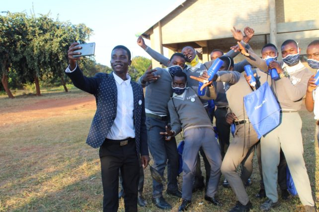Ask Us: Steve Jim Banda, youth facilitator at Ngowe Community Day Secondary school, takes a selfie with some of the speakers at the boys' vulnerability dialogue